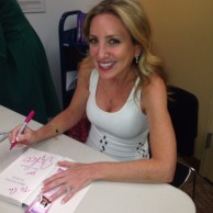 Author Emily Liebert signing books at the release party for her novel Those Secrets We Keep at The Westport Library