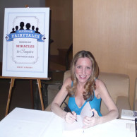 Emily Liebert signing books at her NYC launch party for Facebook Fairytales