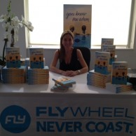 Author Emily Liebert signing copies of her new novel You Knew Me When at Flywheel Sports-Upper West Side in NYC